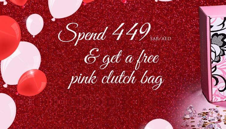 Spend 449 and get a free pink sequined clutch bag Offer at Nayomi, April 2018